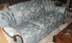 """Beautiful vintage sofa. The fabric is a very pretty light green and is in excellent condition. The wood is also in excellent condition. The sofa measures 83"""" across."""