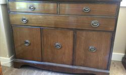 """Very solid wooden buffet could be used in the living room as a tv stand or in the dining room. Measurements are: 45 3/4"""" L x 34 1/4"""" H x 17 3/4"""" D Has two half drawers on top one long drawer in the middle and a cupboard on the bottom with one shelf inside"""