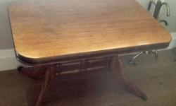 Beautiful, solid wood (walnut) occasional/coffee table. Duncan Phyfe style. Approximately 70 years old, but looks like new.