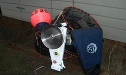 I have six of these commercial stainless prawn traps, 3 scotchmen, 3 rope strings of 350 feet and a ace brutus +40 line hauler with the new style scotty plug, all in great condition. the line hauler may have been used 6 times.