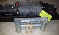 Brand new Warn winch. 8000 lb..capacity with roller fair lead and Chev K2500 mounting plate Warn winch model no. MRV-8-7 No remote. Never used. Mint condition