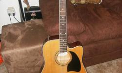 THIS IS A GREAT GUITAR AT A MORE THEN FARE PRICE,IN GREAT CONDITION,THIS GUITAR IS A LYON BRAND.WHICH IS MAE BY WASHBURN,HAS A BUILT IN TURNER,AND CAN PLUG INTO A AMP. WITH A GUITAR CORD AND A MICK CORD,TWO DIFFRENT PLUG INS ,VERY RARE STYLE,GREAT
