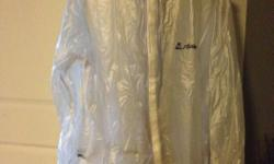 Two see through cycling rain jackets. Activa. Velcro front closing, elasticized at the wrist. One medium, one large.