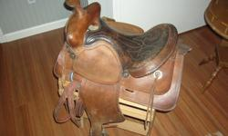 """15"""" western saddle. It wouldn't be considered as a show saddle, although It has a few bright accents and decorative stitching. It's in decent condition, but could perhaps use some cleaning / conditioning. It was used for pleasure riding before we got it."""