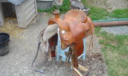 "Westerm Rawhide 1634. 16"" seat. 6"" gullet. Comes with breast plate, front and back cinches."
