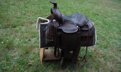 "15"" seat. Nice older saddle. All intact."