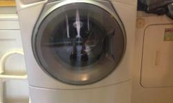Working washer with hoses ready for pickup ASAP