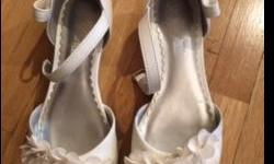 White shoes with pretty flowers on the front of the shoe. Size one. Super cute shoes:) Perfect condition. Small one inch heel.