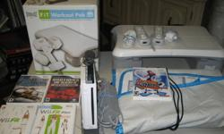 Wii console wii fit &plus & balance board  plus ddr with mat with 2 controllers sensor 2  nunchuks two war games brother in arms and blazing angels Also found another one Wii biggest loser to go with the balance board will not separate sold together