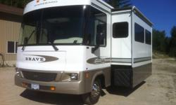 Very Clean 32V Class A , Ford V10 2 slides bedroom and livingroom, generator, full basemnet storage, Hww Levellers, 2 TVs, back up camera, 2 roof AC units,  no pets, non smoker never lived in. Custom painted strips You will not find a clean motorhome! Up