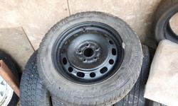 Set of four barely used Arctic Claw snow tires on new black steel rims. 205 60/R/16
