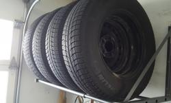 P215 70R 15 Michelin X-ICE c/w steel rims. 70.1 mm center bore with 5 bolt pattern. Under 1500 km on tread and rims.