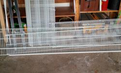 A whole slew of really good wire shelving. Includes supports and screws. Great for redoing closets, or for shelving in workroom or garage. Includes one custom overhead piece over 10' long, which could be cut to fit.