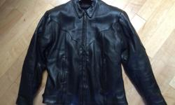 This Women's Leather Motorcycle Jacket is a size large. It is a heavy good quality black leather jacket. It is fitted and flattering but still fits a standard women's large. It was purchased from a vendor at the Anacortes Oyster Run a few years ago. The