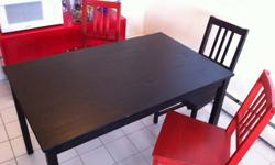 Dark brown wood dining room table 2 brown chairs 2 red chairs Dimensions of Table: 29 1/2 x 47 3/4