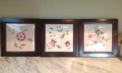 Cute embroidered flowers encased in a wooden frame. Cute for a baby nursery.