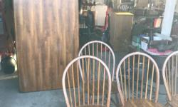 "Solid wood table in good condition 4 chairs one chair has a broken spindle.....3' by 5' and 29"" high"