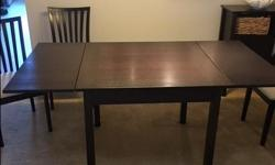 SCAN Design wood table and 4 chairs. Good condition.