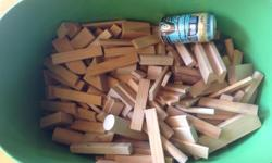 Lag bag of misc shaped wooden blocks. All have smooth edges. Great for building roads, towers, etc. The can in the photo is for size comparison. Trug not included. Some have marks & drawings on them which is reflected in the price.