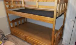 """Birch bunk bed. Can be set up as two twin size beds or as bunk. Drawers in bottom bunk. Safety side on top bunk is removable. Overall nice shape. Measures 80""""L x 40""""W x 62""""T Accepts mattress up to 37""""W x77""""L Handle missing from one drawer. Ladder is"""