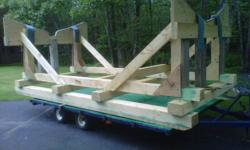 I have over 25 yrs experience building wooden Yacht Cradles. I also have several in inventory. One for 34 to 40  ft + power boat & one perfect fit for Roue 20. Pic is of Nonsuch 30' cradle currently under construction.