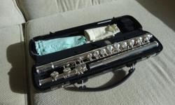 Great for Band class in high school sliver plated closed holes ( good for beginners) hard case and cleaning cloths used one semester Purchased for $400
