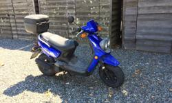 2005 Yamaha Scooter 49 CC (no special license required) Lady owned well maintained Nothing wrong with Turn key and Scoot Away! Missing one mirror(left side) No helmet.
