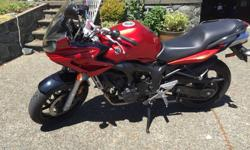 Yamaha FZ6 2006 Sport Touring Bike in excellent condition. Only 15,900 , just fully serviced at SG Power. Both tires almost new. Mint condition- never dropped or ridden hard. The FZ6 bikes of this generation had the inline 4 engine from the R6 with a bit