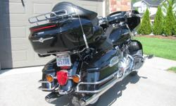 Just in time for Christmas! Absolutely showroom condition. One owner. Fully loaded for long distance touring with over $4,400 of options and accessories included. Helmets, headsets, cover included. Certified. Call for details & viewing. No reasonable