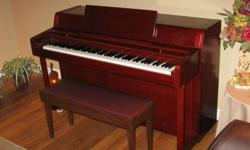 "Yamaha spinet piano, 30 years old, used very little, very good condition, stands 36"" tall, Cherry satin in colour, comes with bench (bench has a padded top) and some beginner books. Also comes with quartz metronome.Yamaha pianos are well know for their"