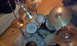 5-piece performance drum kit. Comes with: -Sabian Hi-Hat, -Sabian Crash Cymbal -Sabian AAX Studio Crash Cymbal -Sabian Ride Cymbal -Crash/Ride Cymbal All hardware included! cymbal stands, carrying cases for all the drums-as well as the cymbals, tuning