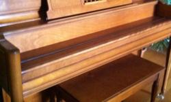 Maple, in excellent condition - with piano bench This ad was posted with the Kijiji Classifieds app.