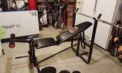 """typical weight bench w/ reclining back rest. 5' straight bar and """"Olympic"""" style curl bar and roughly 75-100lbs in weights"""